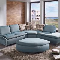 Modernes Sofa mit riesiger Rundecke und passendem Hocker - Stoff bezogen